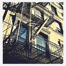 Low Angle View Of Fire Escape Outside Building
