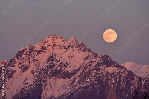 Alpenglow colors the full moon rising over Alaska's Chugach Range фототапет