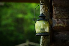Old Oil Lamp Hanging On Wooden Pole