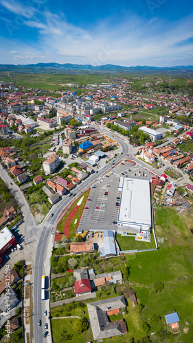 Huedin, Cluj/Romania-05.08.2020-Panoramic portrait photo of Huedin/Banffyhunyad city, with Lidl groceries shop in foreground and city center in background.