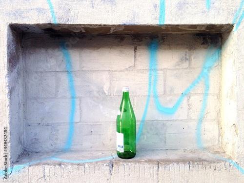 Photo Empty Bottle In Wall Alcove