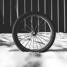 Wheel On Snow Covered Landscape