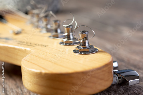 A closeup view of the tuner pegs of an electric guitar. Slika na platnu