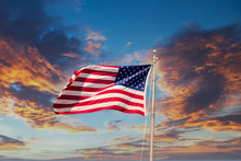 American Flag Waving In The Wind On A Sunset Sky
