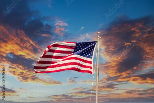 Valokuvatapetti American flag waving in the wind on a Sunset sky