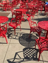 High Angle View Of Empty Chairs By Table At Sidewalk Cafe