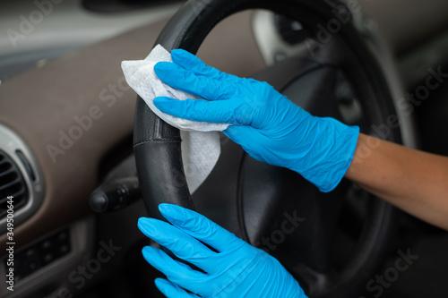 Fototapeta Cleaning car wit antibacterial wet wipes obraz