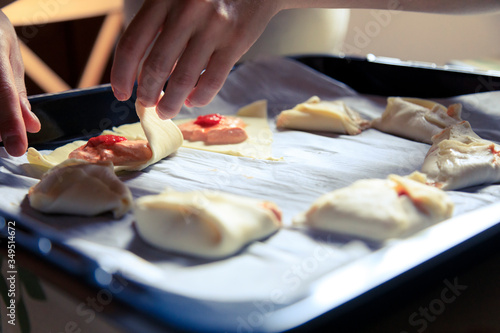 Young woman cooking at home #349514672
