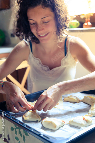 Young woman cooking at home #349516417