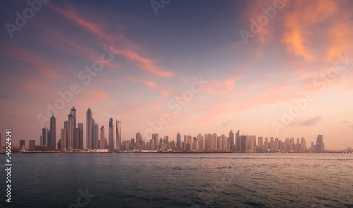 skyscrapers in Dubai Marina, sunset time, UAE #349524841