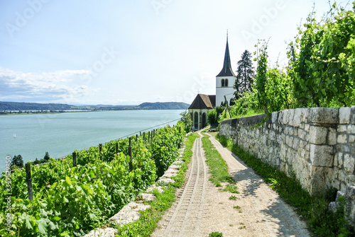 Photo Ligerz at Bielersee. Lake Biel and old church in Switzerland.