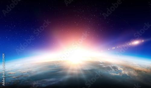 Fototapeta Earth with sunrise on blue space background obraz