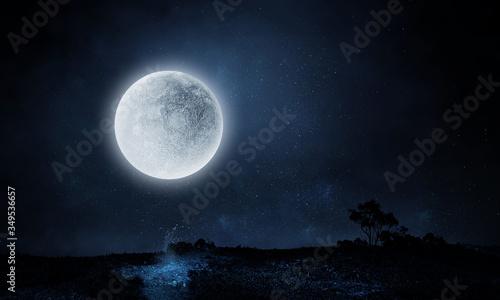 Photographie Full moon over dark night city
