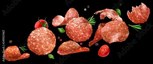 Fototapeta Falling sliced salami isolated on black background obraz
