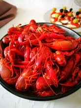Close-up Of Fresh Red Prawns In Bowl On Table