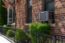 Outdoor Window Air Conditioning Units On An Old Brick New York City Apartment Building During Spring