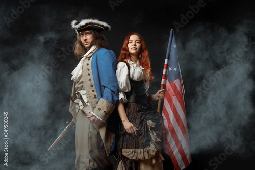 Fotografie, Obraz Man in form of officer of United States War of Independence and girl in historical dress of 18th century