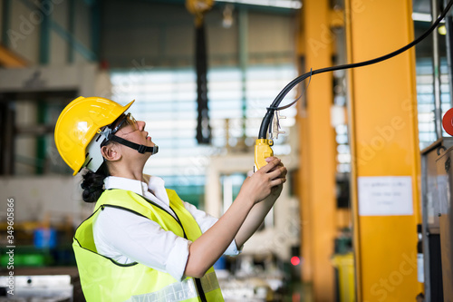 Photo Factory worker control trolley crane