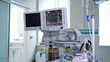 Contemporary medical system in the operating room. Monitor and machine ventilator in hospital theater. Modern equipment to show vital signs of a patient in the hospital.