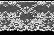 White Floral Lace On A Black B...