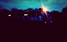 Illuminated Train Against Sky At Dusk