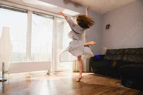Fototapeta Woman dancing at home at isolation time obraz