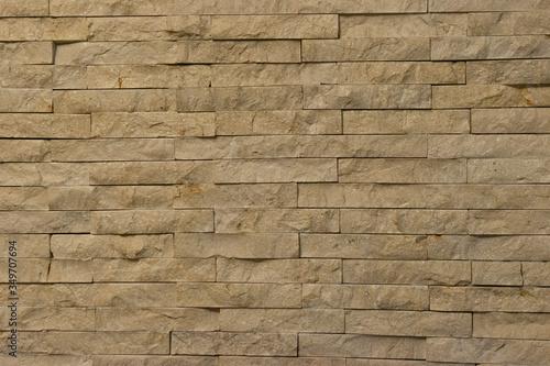 Fotografija pared antigua de piedra espacato, piedra rectangular, textura rocosa color beige