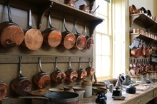 Copper Pots Hanging Of A Wall ...