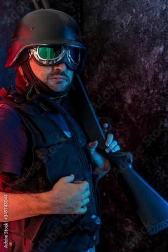 Photo Counterterrorist Holding Ak-47 Against Wall