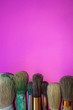 canvas print picture - Close-up Of Paintbrushes On Purple Background
