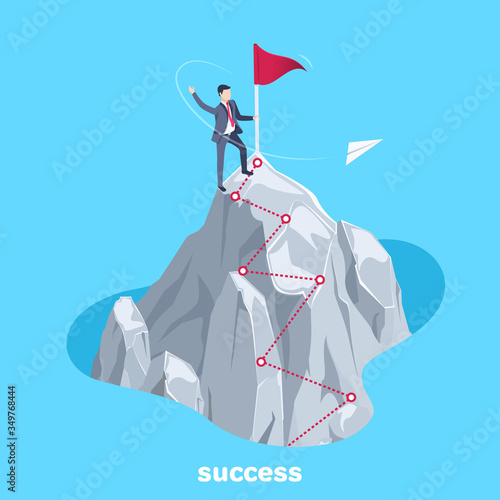 isometric vector image on a blue background, a man in a business suit stands on top of a mountain near the flag and the path to success is in the form of a dotted red line Fotomurales