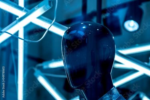 Fotografía Close-up Of Mannequin Against Fluorescent Lights In Darkroom