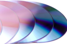 High Angle View Of Compact Discs On White Background
