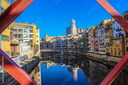 View of the Onyar river from the iron bridge in Girona