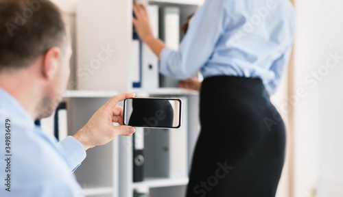 Photo Man Taking Picture Of His Female Coworker's Ass In Office