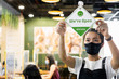 canvas print picture - Business owner Asian woman wear protective face mask ppe hanging open sign at her restaurant / café, open again after lock down due to outbreak of coronavirus covid-19