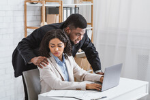 Sexual Misconduct In Office. Boss Touching Shoulder Of Disgusted Female Colleague At Workplace