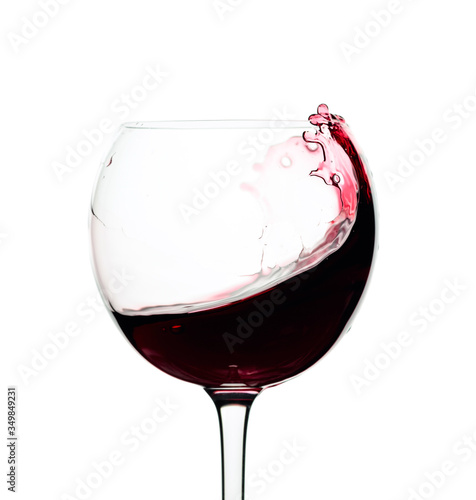 Fotografie, Obraz Splash of red wine in a glass isolated on  white.