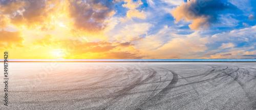 Fototapeta Race track road and lake with sky cloud landscape at sunset. obraz