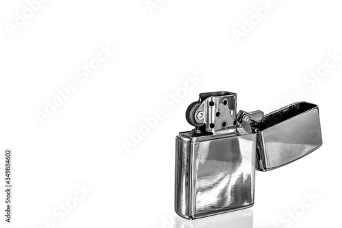 Fotografía Close-up Of Cigarette Lighter Over White Background