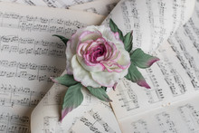 Artificial Rose On Music Notes...