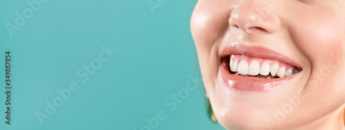 Laughing woman mouth with big teeth on a blue background Fototapet