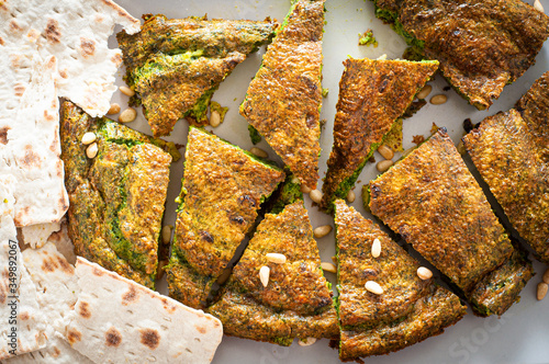 Mixed herb Kuku, a traditional Iranian frittata, served as an appetiser or part of a mezze spread Canvas Print