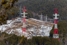 In The Forest On The Field There Are Towers With Power Lines, (high Voltage, Voltage Wires) A View From A Distance, Industrialization In The Forest And The Problem Of Ecology