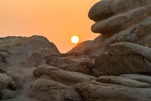 Sunrise Over The Sea And Stone At The Seaside Of Mount Putuo In The Morning, An Island Southeast Of Shanghai In Zhoushan, Zhejiang, China, The Bodhimaṇḍa Of The Bodhisattva Guanyin.
