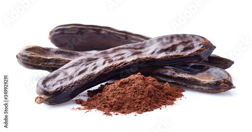 Fototapeta Carobs pod with powder in closeup on white background obraz