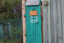 Strange Postbox In A Garden Door
