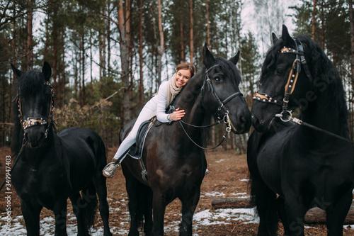 Fabulous young woman on a horseback, outdoor portrait Canvas Print