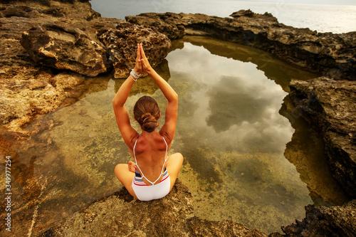 Woman practices yoga at seashore Canvas-taulu