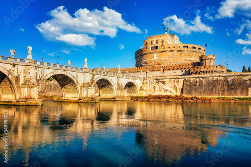 Valokuvatapetti Saint Angel Castle and bridge over the Tiber river in Rome at sunny day